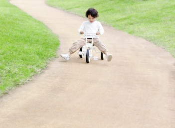 Boy on Tricycle