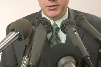 Man Speaking Into Microphones financial media