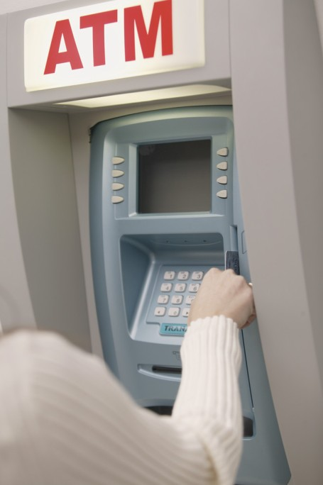 Woman Using Atm Machine